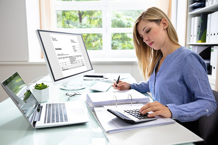 woman using computer and calculator