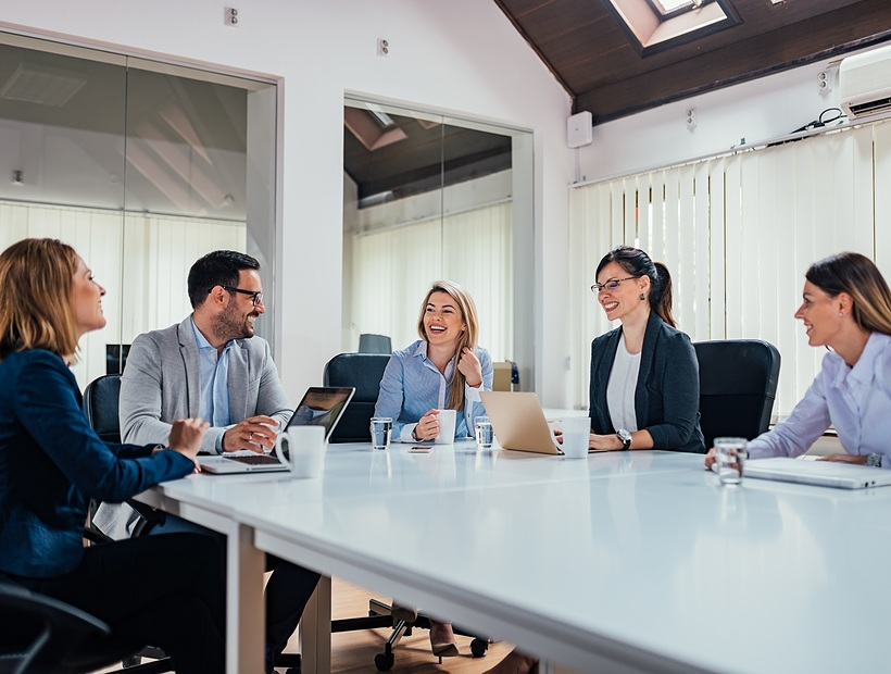 group of people sitting in meeting room